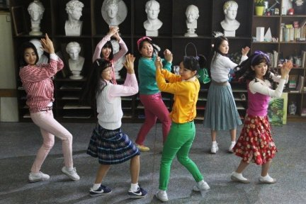 The girls become close friends through song, dance and school life