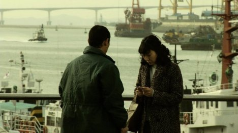 Jung-rim must visit the docks to escape her country