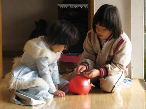 Jin and Bin work hard to fill their piggy bank