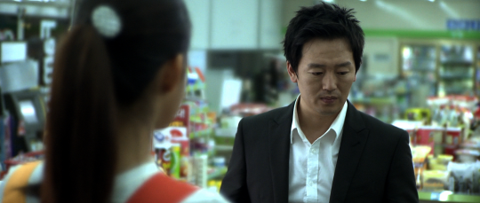 The man attempts to forge a relationship with a convenience store worker