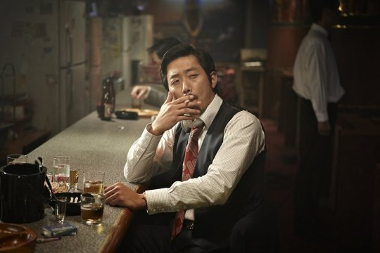 Hyeong-bae is the consummate gangster - stoic, powerful, and deadly