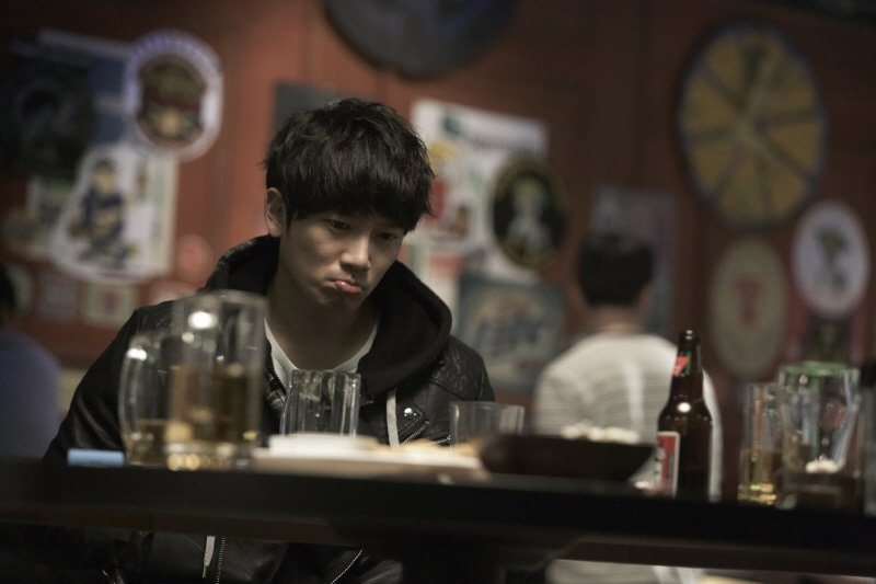 Lonely and depressed, Hyeon-seung consols himself with alcohol