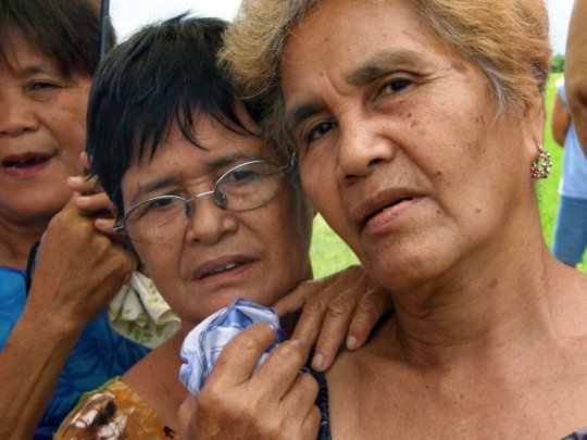 Senior Filippino women discuss past atrocities comitted by Japanese soldiers