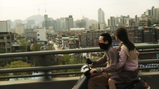 Joon and Soon-hee traverse the unwelcoming Seoul landscape