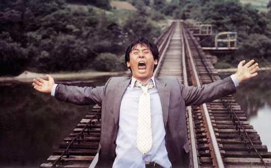 Kim Yeong-ho climbs atop the rail tracks, ready for death