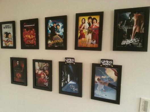 Posters of the films produced by REALIES Pictures adorn the walls