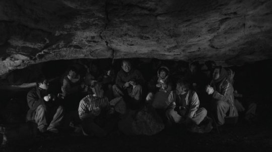 The residents of the town seek shelter and safety in a cave