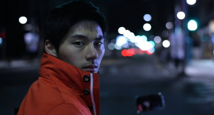 Courier Tae-jun sports an iconic orange jacket, revealing much about his character