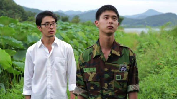 Soldier Gi-tae's uniform blends with the green landscapes