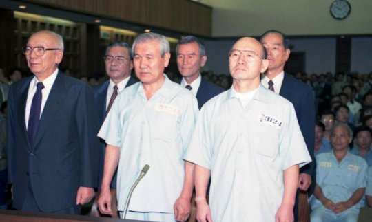 Chun Doo-hwan (right) and Roh Tae-woo are arrested (and later pardoned) for their role in the Gwangju Massacre