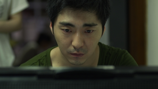 Hae-gang's intense passion for filmmaking creates conflict in his professional and private life