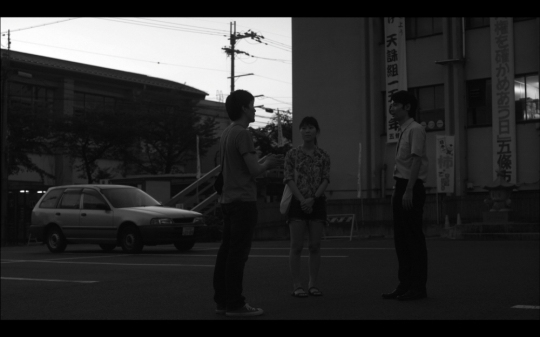 The director, translator and Japanese guide communicate while traversing Gojo City