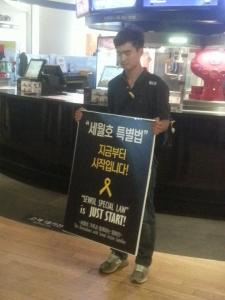 A young man protests in regard to the special Sewol law outside of the screening
